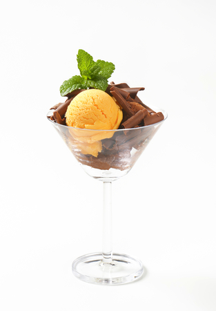Scoops of ice cream with chocolate curls in stemmed glass