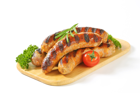veal sausage: Grilled German sausages on cutting board