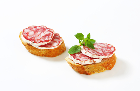 Canapes with slices of French dry sausage