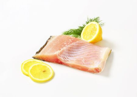 Raw carp fillet with lemon and dill