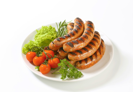 Pile of grilled sausages on plate