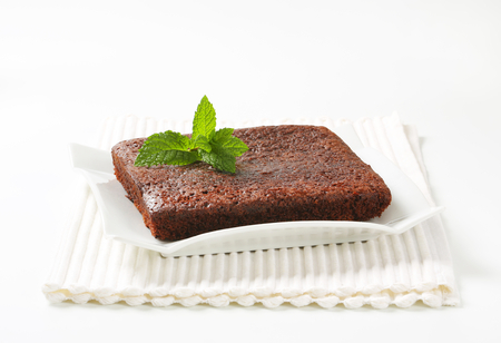 Chocolate Brownie on modern square plate Stock Photo