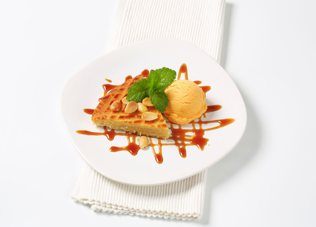 Dutch butter cake with scoop of ice cream and caramel sauce