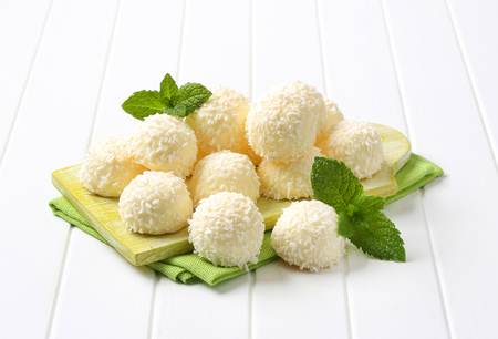 desiccated: White chocolate snowball truffles rolled in coconut Stock Photo