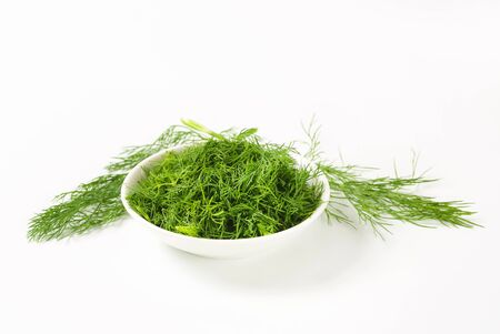 Bowl of fresh chopped dill leaves Stock Photo