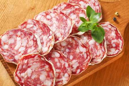 Sliced French dry sausage (Saucisson Sec)  on cutting board Фото со стока - 80712183