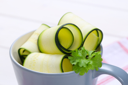 cup of raw zucchini strips - close up