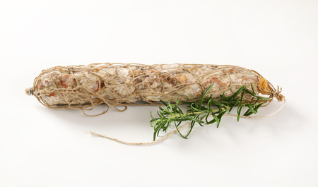 air dried: Dry cured pork sausage and rosemary on white background