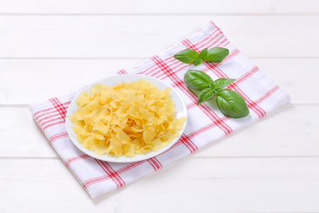 plate of quadretti - square shaped pasta on checkered dishtowel Stock Photo