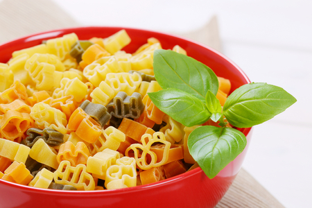 bowl of raw colored pasta - close up Stock Photo