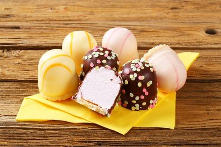 Assorted marshmallow treats on yellow napkin Reklamní fotografie
