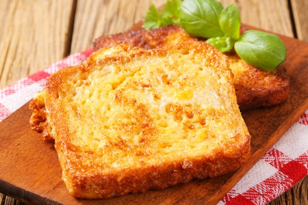 French toast - Bread soaked in beaten eggs and then fried Stock Photo