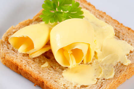 Fresh butter curls on bread