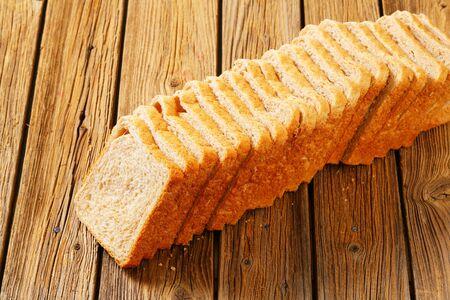 Sliced loaf of whole wheat sandwich bread
