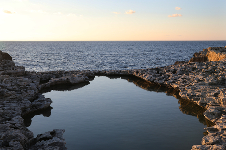 Rock pool and view of the sea from the shore of Malta Reklamní fotografie