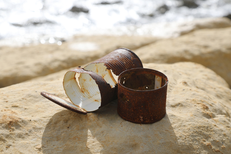 Old rusty cans left on the sea shore Reklamní fotografie