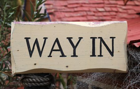 White wooden way in sign