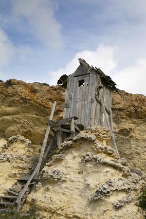 Small shack on rock in Popeye village, Malta