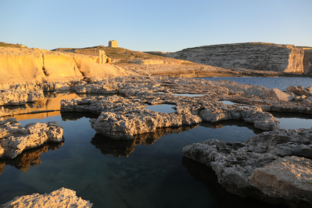 Maltese coastline with cliffs and old watch tower