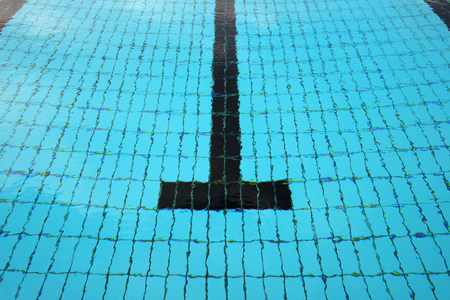 Above view of quiet water surface and lane in swimming pool