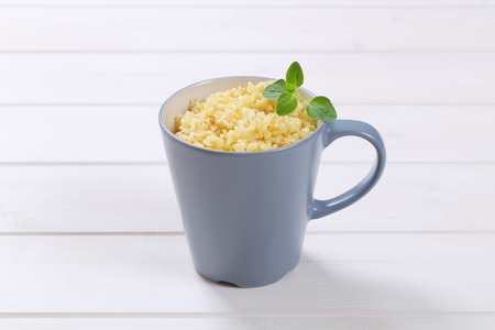 Cooked whole groats  in a cup Stock Photo