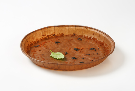 empty round paper baking pan on white background
