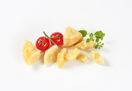 pieces of fresh parmesan cheese and cherry tomatoes on white background Reklamní fotografie