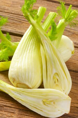 bulbs of fresh fennel on wooden background Reklamní fotografie