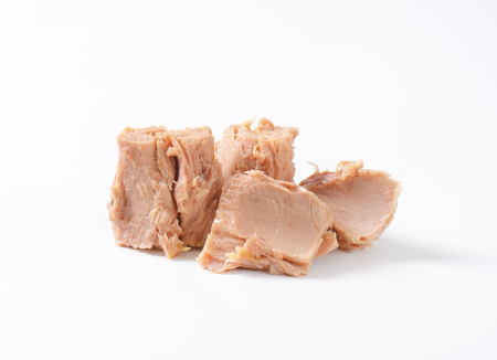 pieces of canned tuna on white background