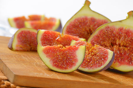 fresh sliced figs on wooden cutting board - close up