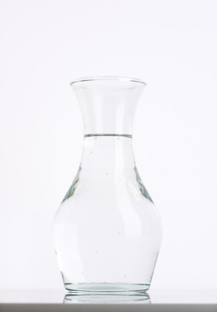 carafe of fresh water on white background