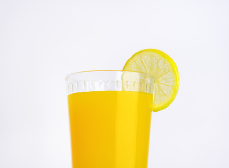 glass of orange juice on white background - close up