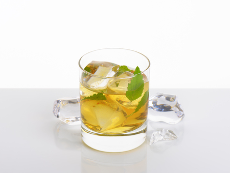 glass of apple juice with ice on white background Reklamní fotografie