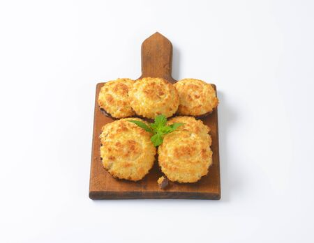 sweet coconut cookies on wooden cutting board