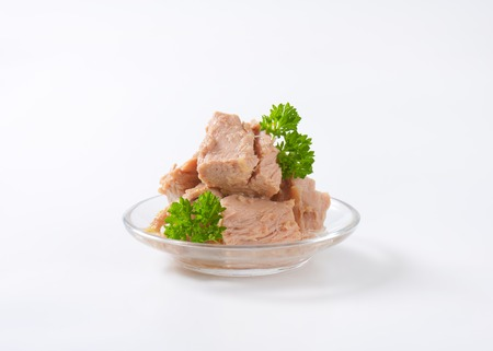 bowl of canned tuna with parsley on white background Reklamní fotografie