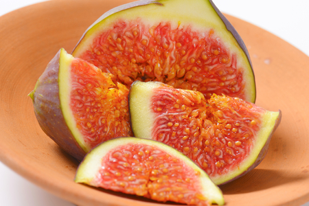 close up of fresh sliced fig on terracotta bowl Reklamní fotografie