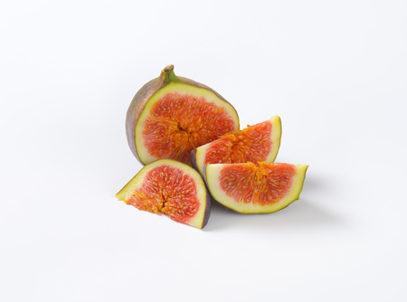 fresh sliced fig on white background