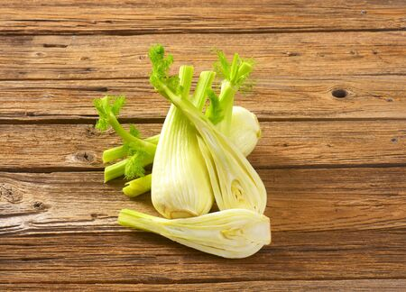 bulbs of fresh fennel and kitchen knife on wooden background Reklamní fotografie