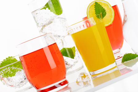 variety of summer cold drinks on white background - close up