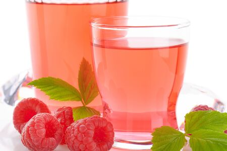 glasses of raspberry juice and fresh raspberries on white background - close up Reklamní fotografie