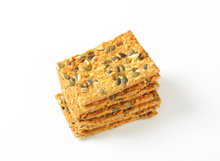 Whole grain crackers with cheddar and pepitas Stock Photo