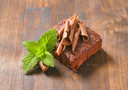 Brownie topped with chocolate curls Stock Photo