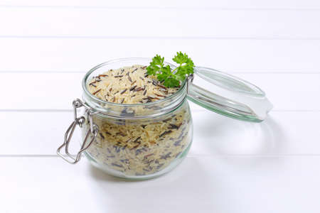 jar of wild rice on white wooden background