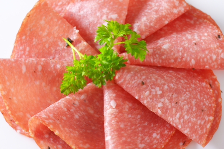 detail of thin slices of spicy salami with parsley