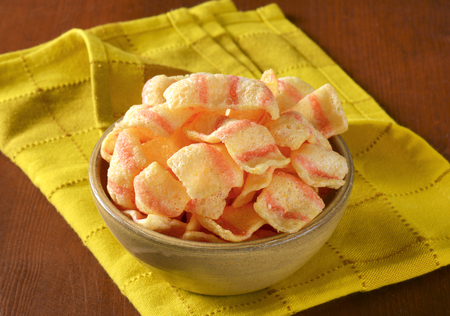 Bowl of bacon-flavored puffed wheat chips