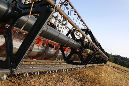 Closeup of combine harvester reel in field