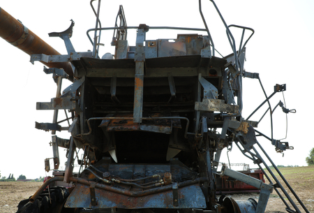 Closeup of a burnt out combine harvester in field Reklamní fotografie