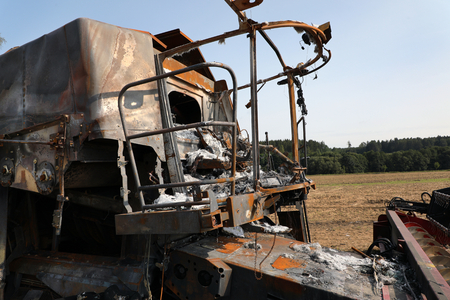 Closeup of a burnt out combine harvester in field Reklamní fotografie