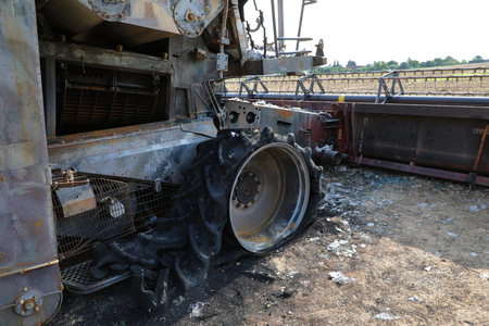 Closeup of combine harvester destroyed by fire