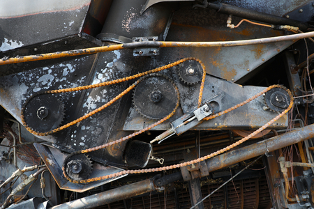 Detail of a burnt out combine harvester